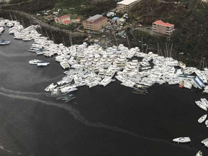 India Tv - Boats slammed together by Hurricane Irma in Caribbean