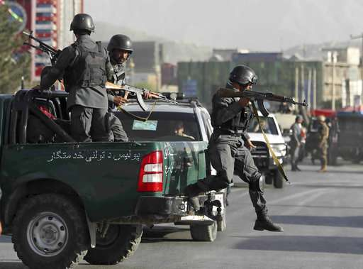 File photo. Afghan security forces outside a blast site.