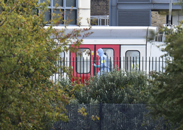 A forensics officer on the platform at Parsons Green