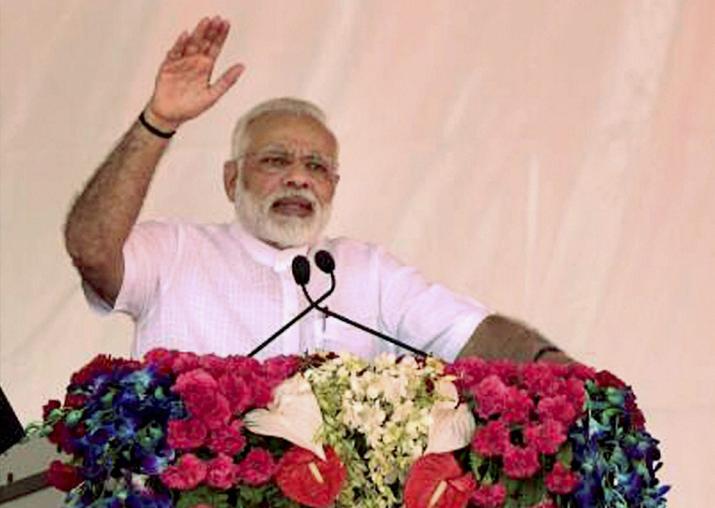 PM Modi addresses a gathering during Pradhanmantri Aawas