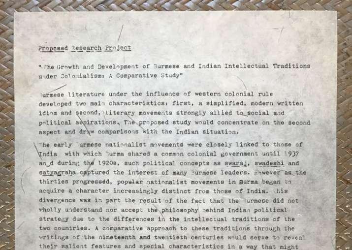 PM Narendra Modi presents Aung Suu Kyi copy of her research