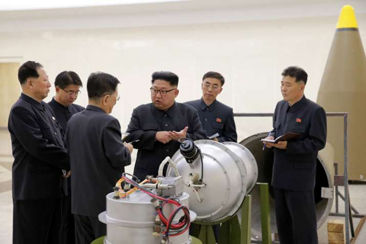 India Tv - Photo by North Korea's govt shows Kim Jong Un at Nuclear Weapons Institute