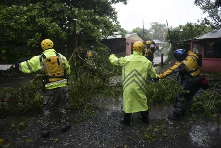 India Tv - Rescue staff searching for citizens during passage of Hurricane Irma in Fajardo