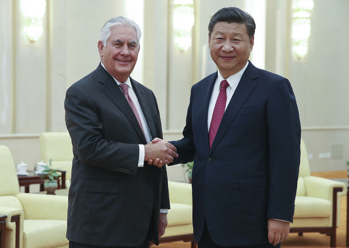 Rex Tillerson shakes hands with Xi Jinping at the Great