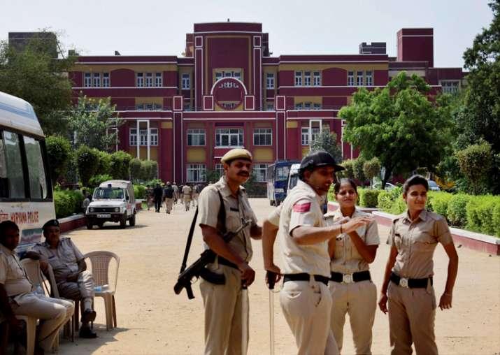 Gurugram Police officials outside Ryan International School