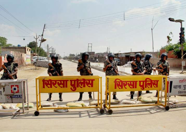 India Tv - Security forces stand guard at entrance to Dera Sacha Sauda HQs in Sirsa