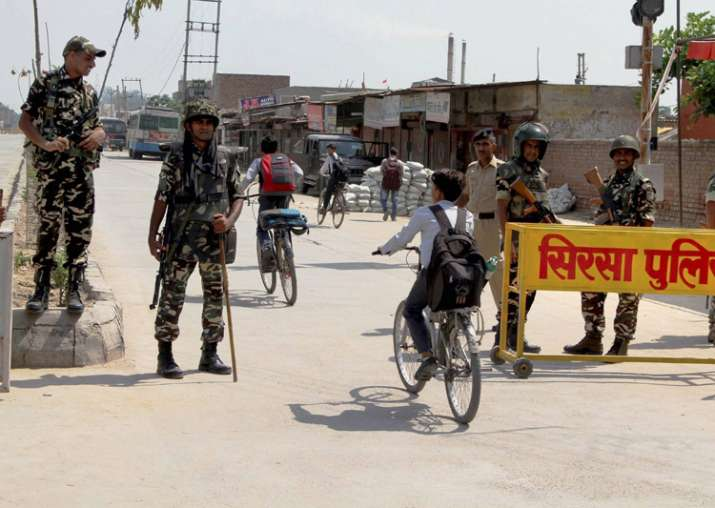 Security forces stand guard at Satnam Chowk, the main