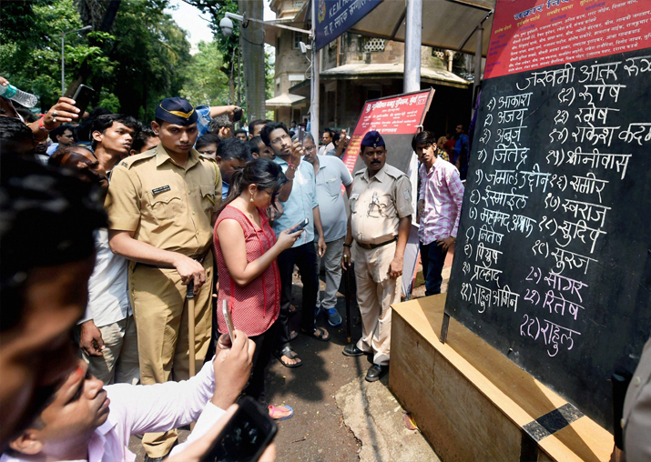 Elphinstone stampede: Relatives check for the names of