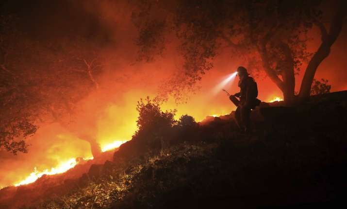 India Tv - A firefighter monitors a flare up above the Sonoma Valley, Wednesday
