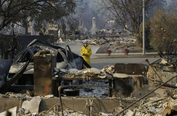 India Tv - Forester Kim Sone inspects damage at homes destroyed by fires in Santa Rosa California, Thursday