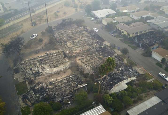 India Tv - Aerial image shows a neighborhood that was destroyed by a wildfire in Santa Rosa, California