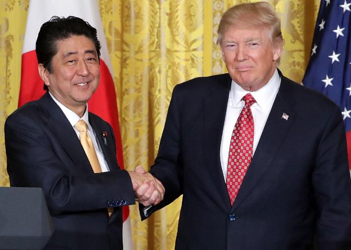 File pic - Donald Trump congratulates Japan PM Shinzo Abe