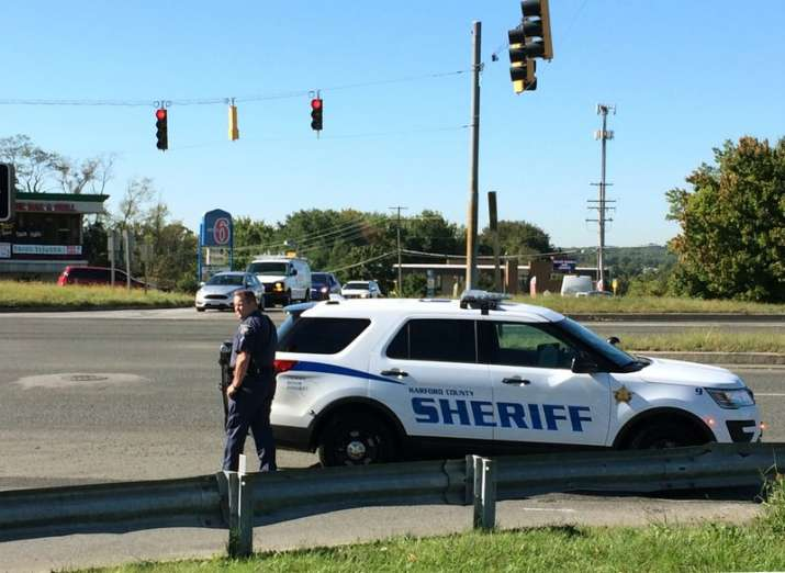 Police respond to a shooting at a business park in the