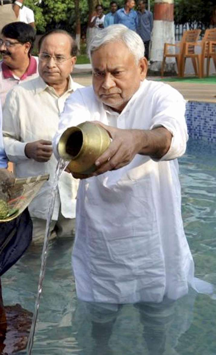 India Tv - Bihar Chief Minister Nitish Kumar performs Chhath Puja rituals at his official residence in Patna on Thursday