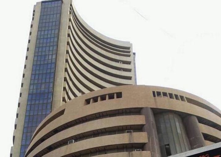 Market scales new peak; Sensex gains 104 points to end at