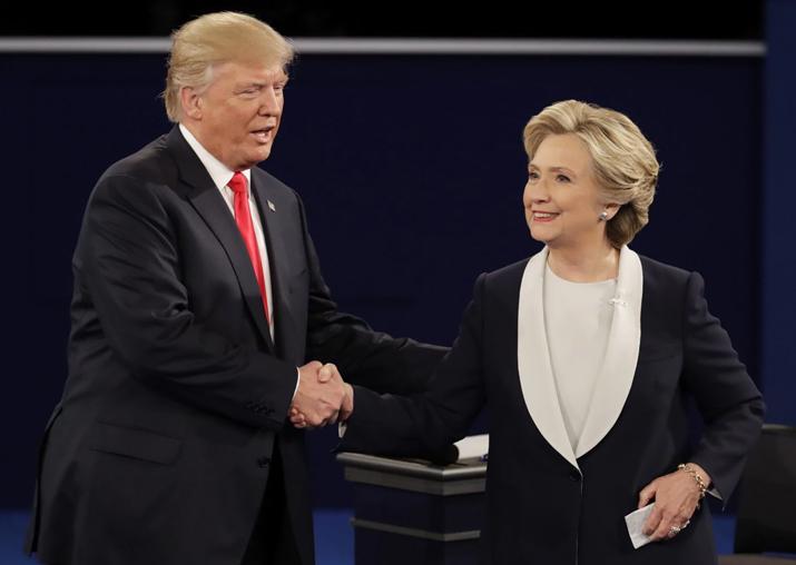 File pic - Donald Trump dares Hillary Clinton to run in