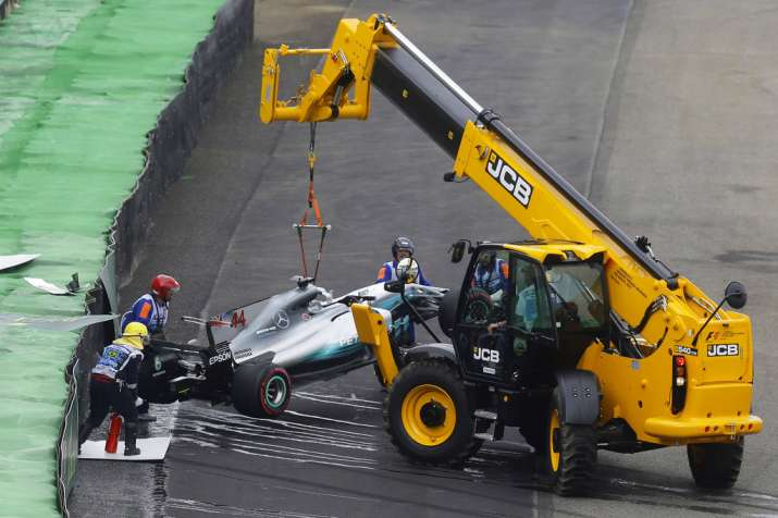 India Tv - A file image of Lewis Hamilton's car being towed after the crash.