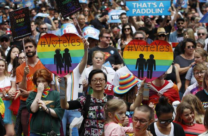 Image Source : AP Supporters of marriage equality march near Victoria Park  in Sydney on October 21. Australians ...