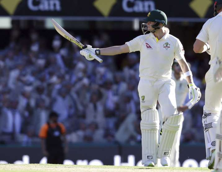 India Tv - Steve Smith celebrates after scoring his century.