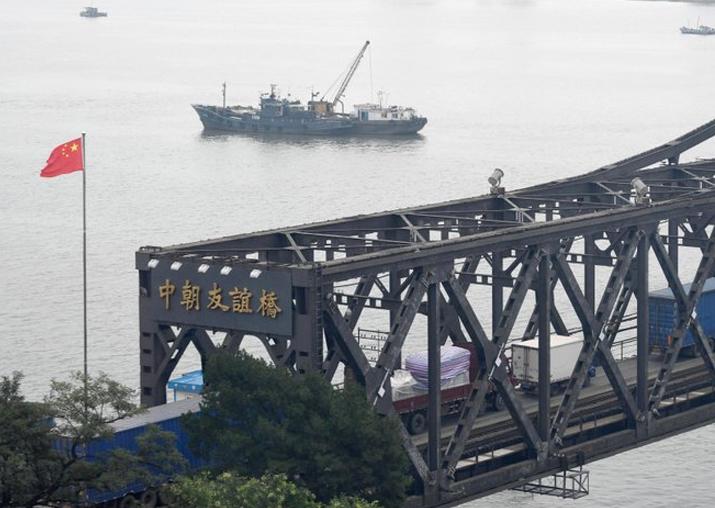 File pic - Trucks transport goods to North Korea through