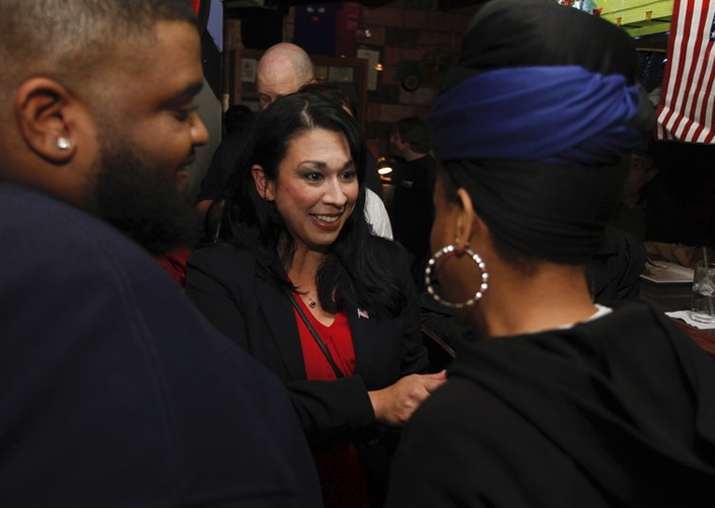 Kelly Convirs-Fowler greets her supporters as results come
