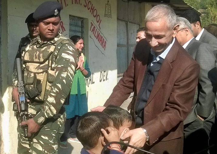 Dineshwar Sharma during a visit to a government primary
