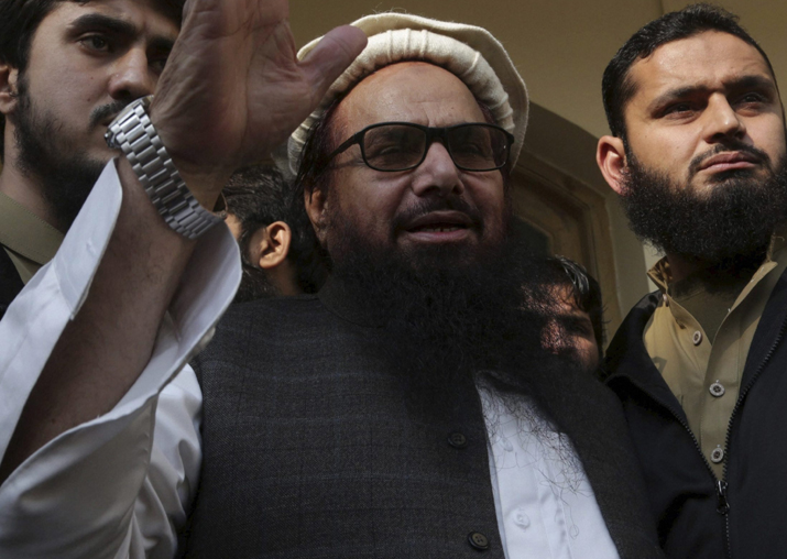 Hafiz Saeed waves to his supporters at a mosque in Lahore