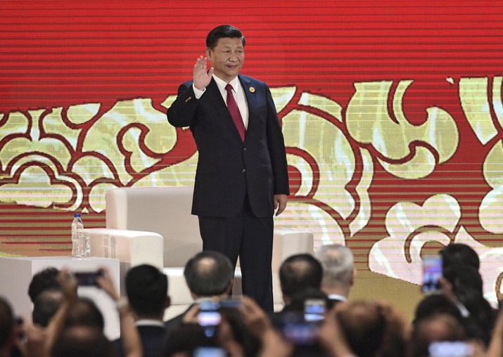 Xi Jinping arrives to speak on the final day of the APEC