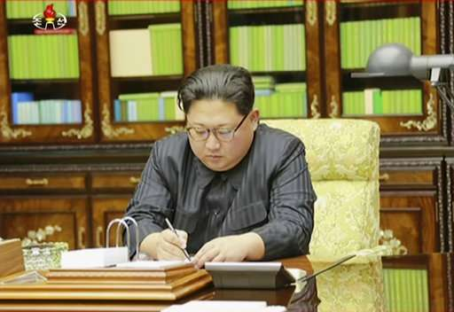 North Korea's leader Kim Jong Un signing what is said to be