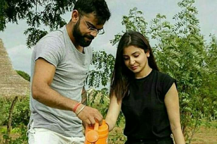 India Tv - Virat and Anushka watering a plant in Sri Lanka