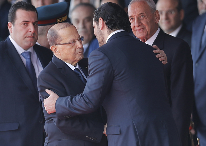 Lebanese President Michel Aoun is greeted by PM Saad Hariri