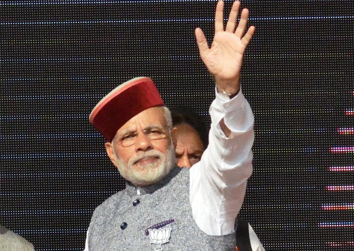 PM Narendra Modi waves at crowd during BJP Parivartan Rally