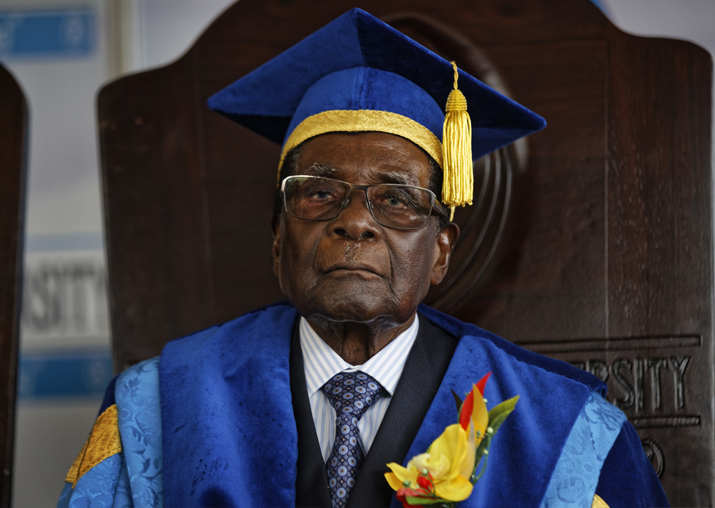 Zimbabwe's President Robert Mugabe sits for formal
