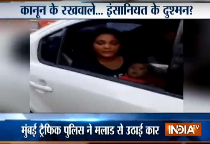 Mumbai traffic cop tow away car with woman breastfeeding