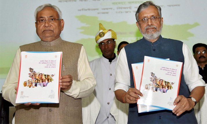 India Tv - Nitish Kumar with deputy CM Sushil Kumar Modi releases a book during the Non Alcohol Prohibition Day function in Patna on Sunday