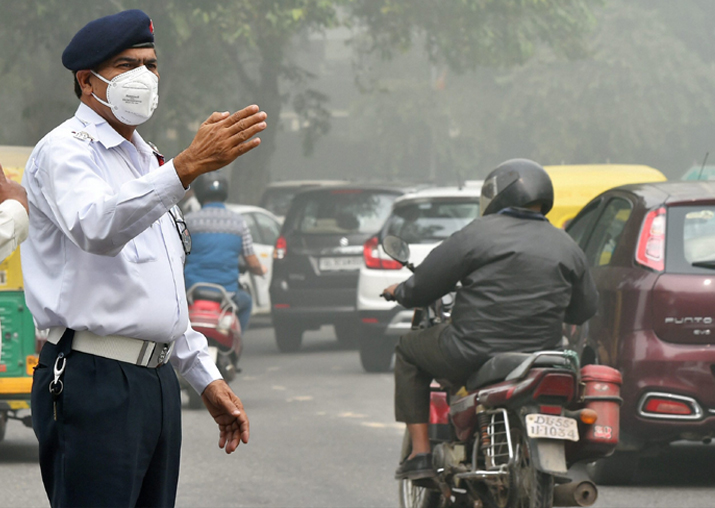 Traffic policemen wear masks to protect themselves from