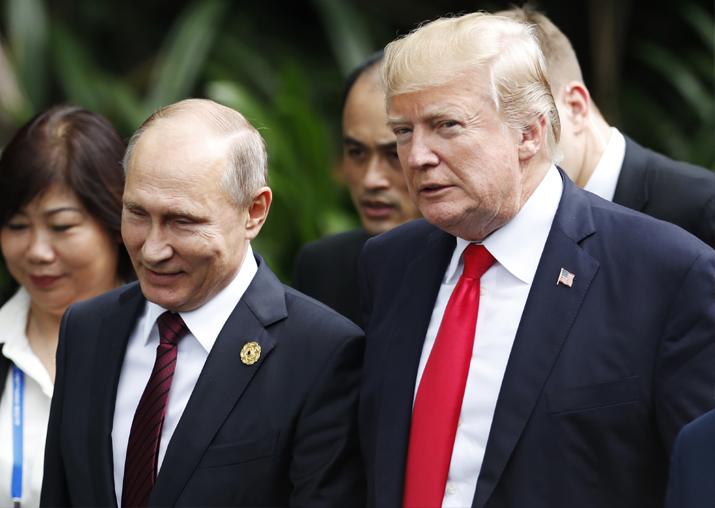 Donald Trump and Vladimir Putin talk during the family