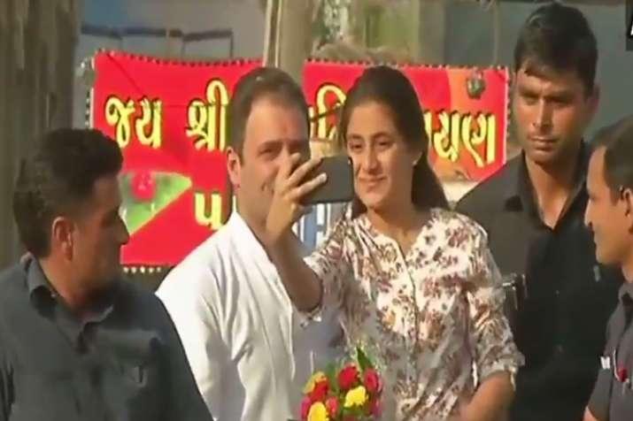 Bharuch girl climbs onto Rahul Gandhi's van, takes selfie