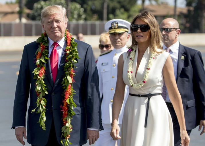 India Tv - Donald Trump and first lady Melania Trump wear leis as they arrive at Joint Base Pearl Harbor Hickam, Hawaii