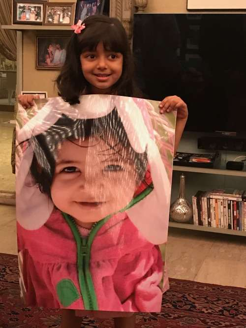 India Tv - Aaradhya holding a picture of her younger self