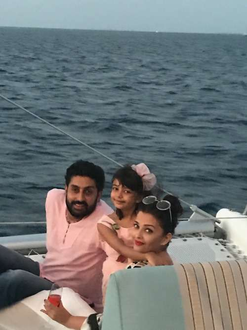 India Tv - Aaradhya Bachchan with mother Aishwarya Rai and father Abhishek Bachchan