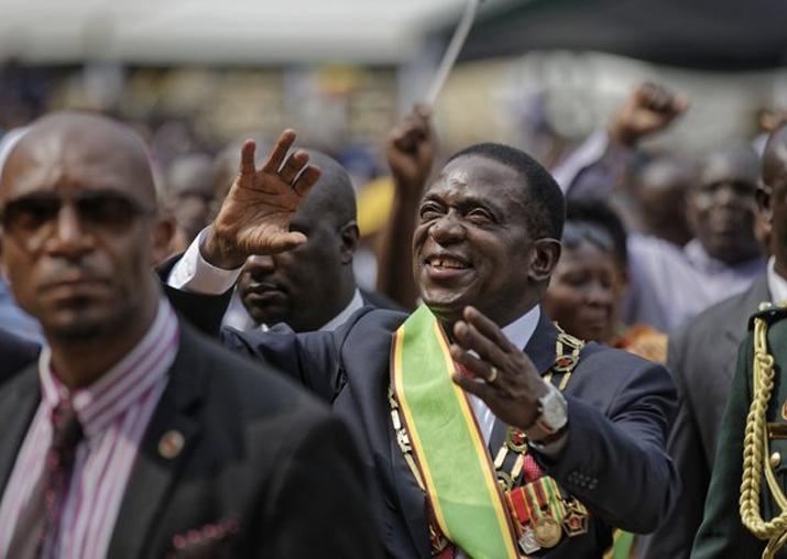 Zimbabwe's President Emmerson Mnangagwa gestures to the