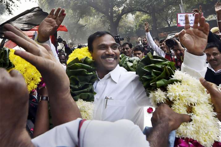 Former Telecom minister A Raja reacts as he celebrates