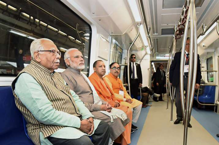Prime Minister Narendra Modi takes a ride in a Metro from
