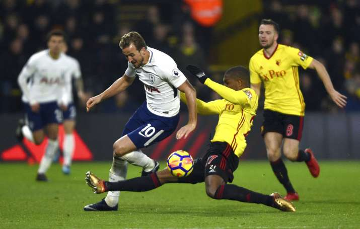 India Tv - Watford players tackle Spur's Harry Kane.
