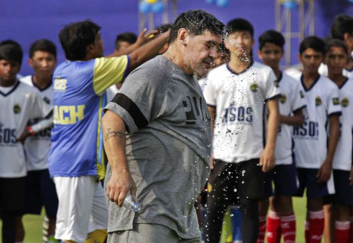 India Tv - Maradona plays with the kids