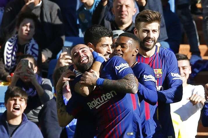 India Tv - Barca players celebrate Vidal's goal.