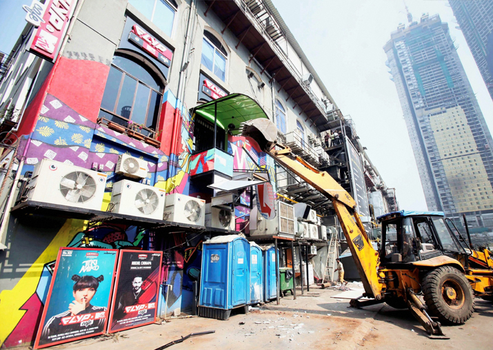 India Tv - BMC bulldozer takes down illegally constructed eateries in the Kamala Mills compound following the fire incident
