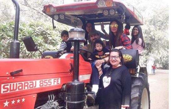 Taimur and family taking tractor ride