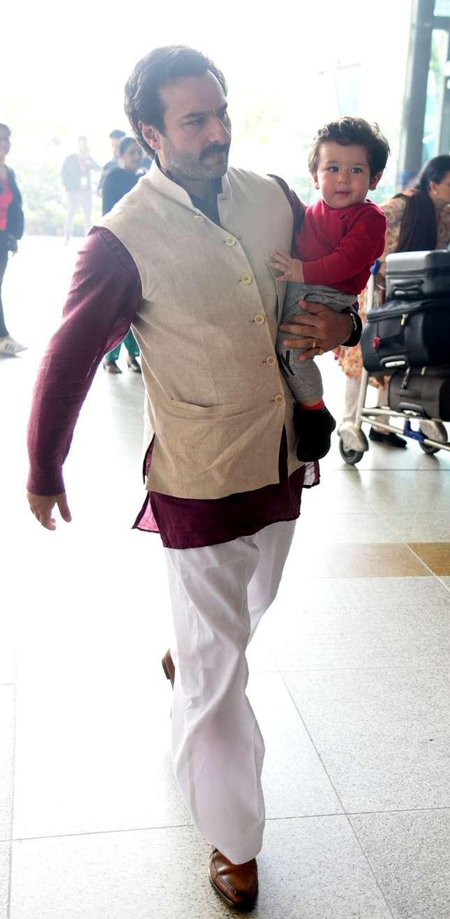 India Tv - Saif Ali Khan with Taimur at Delhi airport